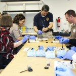 "Class participants receive training on FBI fingerprinting techniques on Evidence Response Team (ERT) night. This particular shot shows the use of magnetic particles instead of traditional ""dust."""