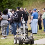 The FBI bomb squad presentation on range day included a demonstration of a robot, inert examples of improvised bombs, and an actual detonation of two types of bomb material (TNT and C4).