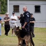 A CMPD officer demonstrates a police dog on range day at CMPD's training facility. An FBI bomb dog was not available, so we got a presentation on a drug-sniffing dog. This particular dog was a few short days away from permanent retirement after serving a long career as a police dog.